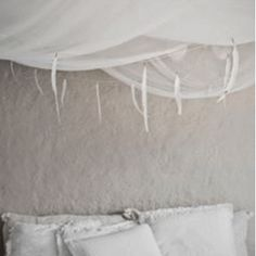 Feather Festoon: This whimsical feather festoon is the perfect finishing touch for a room - to frame a headboard, hang from a curtain rail or surround a fireplace.   - Made with 26 off white feathers  - 10 meter cotton string - Gold plated details