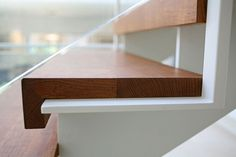 Very clean and simple stair detail. The combination of wood and steel is excellent.