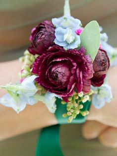 Wristed blooms Instead of bouquets, order your girls corsages that look more like bracelets with ribbon and a mix of fun flowers. We're not talking about the cheesy ones you wore to your high school formal.