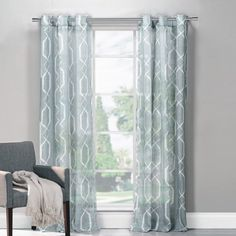 A lovely addition to your living room or master suite, this elegant curtain showcases a trellis motif and blue hue.  Product: Se...