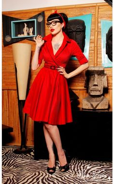 This ghoulishly glamorous dress from Deadly Dames features a faux wrap style top creating a stunning plunge neckline, a belted waist, and opens up into a full pleated skirt retro style skirt. The angled French cuffs are held together with custom made skull faux cufflinks. Made from a luxurious stretch sateen with contrast piping. - See more at: http://www.pinupgirlclothing.com/deadly-haunted-red.html#sthash.cUGOZgtW.dpuf