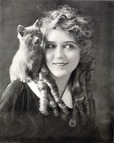 Mary Pickford in 1916 with a kitty pal. She made 251 movies in her three decade career. link