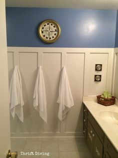 Turn an old clock into a COMPASS. Great idea for a kids' bathroom!