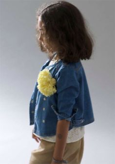 pom pom broach on a sweet little girl
