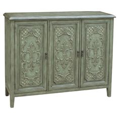 3-door cabinet with fleur-de-lis details and a verdigris finish. Product: CabinetConstruction Material: Hardw...