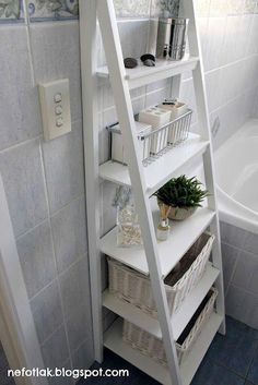 I might take a World Market shelf and spray it white for more bathroom storage in one of the bathrooms. #bathroomfurniturewooden