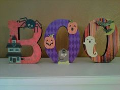 Halloween decor. Scrapbook paper on 3D cardboard letters. Fall 2011.