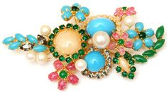 This brooch is a Dior 1950 original! Carole Tanenbaum talks about vintage costume jewelry, discussing the major designers (such as Coco Chanel, Schiaparelli, Trifari, and Schreiner), popular fashion trends, and the origins of costume jewelry....gathering inspiration for our Mrs. Lilien feature!