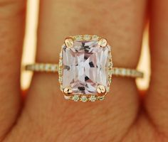 This is one of the versions of my best seller Peach Sapphire Ring The sapphire is 222ct, unheated and untreated, eye clean. The color is peach champagne with lavender overtone, very soft and feminine.  14k rose gold halo setting, TDW approx. 0.2ct. Size 6  This ring is ready to ship. USPS priority