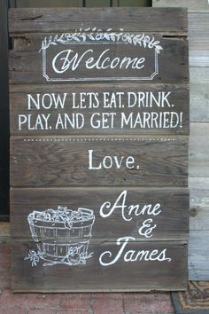 Reception welcome sign for apple orchard wedding. apple leaf and bucket of apples detail. Made from reclaimed barn door