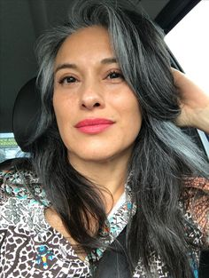 This woman has totally nailed it. Her salt and pepper hair really suits her. She has long shiny and healthy grey hair. Hair goals!!