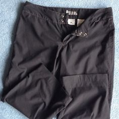 Black Capri Women's workout pant Black Capri pants. Zip and snap front. Two back pockets and one front zip pocket (small). Polyester machine wash .Gently worn. Columbia Pants Capris