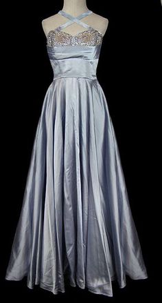 Circa 1950's, Norman Hartnell designed for a young Queen Elizabeth. Regal satin gown, boned with hidden zipper, rhinestone and clear faceted sequins. Removable straps. $3400.00