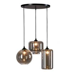 The Irene Pendant from Urban Habitat is ideal for giving your space contemporary style. This modern pendant showcases 3 lights that hang at differing lengths. Each light has a grey glass shade in a differing shape for an interesting look . Modern Victorian Decor, Victorian Lighting, Wood Pendant Light, Pendant Lighting, Dining Room Lighting, Home Lighting, Home Door Design, Industrial Style Lamps, Grey Glass