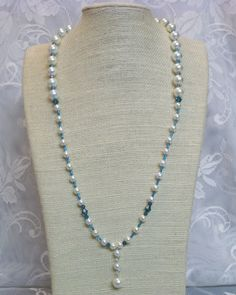 """This necklace will give you """"that something blue"""" on your special day. Beautiful dark blue and light blue elements will make your day special. This simple pearl necklace is exactly what you're looking for.     #wedding #jewelry #fashion #bride #blue"""