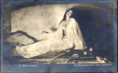"""A Russian postcard depicting a woman smoking opium titled """"Awakening from Opium"""" by A. Matignon. (""""Special thanks to josefnovak33 for his translation"""", as copied from Tumblr)."""