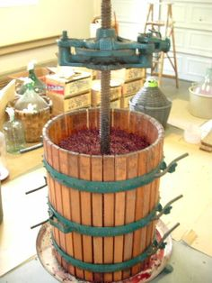 "making wine - wine press www.LiquorList.com ""The Marketplace for Adults with Taste"" @LiquorListcom #LiquorList"
