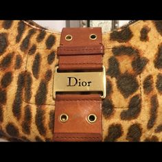 Christian Dior Leopard Print Handbag. Gold accents Christian Dior pony fur handbag with leopard print and gold accents.  This is another great night out bag from my collection.  Holds more than just a cell phone and money.  It fits snug under your arm as a shoulder bag.  This bag was purchased in NYC.  100% Authentic or your money back.  Comes from a smoke-free home and is in GOOD condition.  Minor wear on leather shoulder, strap can easily be repaired by shoemaker. Dior Bags Shoulder Bags