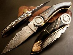 Damascus steel ate its finest.  This folding blade knife could be in an art gallery.