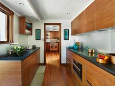 The new kitchen provides much-needed functionality without impacting the spatial rigor of Kahn's architecture or the elegance of Wharton Esherick's intact craftsmanship; it also helps reduce wear on the Esherick kitchen.