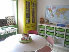 IKEA Trofast workboxes for homeschool room. Love the yellow armoire, too. And the white table.