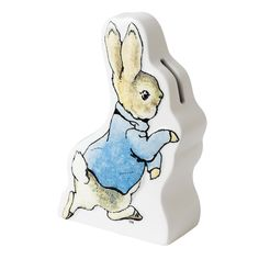 This Peter Rabbit running money bank illustrates Peter the rabbit from the famous Beatrix Potter stories. It would make an ideal nursery gift. Peter Rabbit Baby Gifts, Peter Rabbit Nursery, Beatrix Potter Figurines, Rabbit Run, Money Bank, Disney Traditions, Gifts For New Parents, Christening Gifts, Childrens Gifts