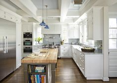 while not married to this configuration, if may be an idea for flow (on right-hand side of photo anyway). Dislike the beams in ceiling. Interested in these tiles as an alternative, particularly since we're going white on cabinets.
