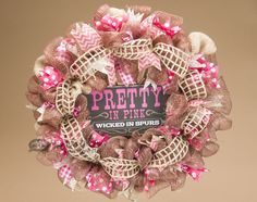 """Show off your western cowgirl spirit with this classic burlap and ribbon wreath, featuring a plaque that reads """"pretty in pink, wicked in spurs.""""  This rustic wreath is perfect for use as a door wreath or wall wreath, and also makes a great gift for any girl who loves her boots and showing off her western style!  See this wreath and more western and southwestern decor at http://www.missiondelrey.com/western-wreath-22-pretty-in-pink-wicked-in-spurs-p345/"""