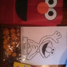 Elmo party favors. Color page. Crayons. Goldfish. And red candy.