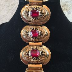 """Vintage bracelet Brilliant red rectangle stones adorned with pearls. Intricate detail in the metal. Each oval section is 1 3/4"""". Excellent vintage condition. Jewelry Bracelets"""