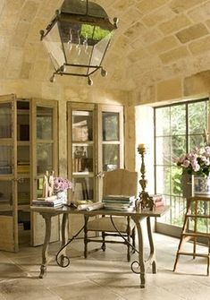 home office with stone ceiling and large tiled floor, lots of windows and built-ins