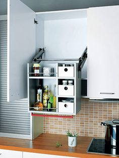 Drop down accessible shelves>> so cool! http://www.medicalcaresolutions.nl/page/Verstelbaar-keukenframe