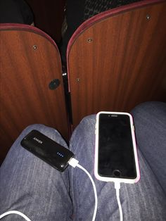 Charging up the phone while at a broadway show. Anker travel charger essential gadget when out and about