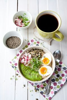 Savoury oatmeal avocado and egg bowl recipe - creamy and salty porridge, with avocado, egg, radishes, cress and toasted seeds. Yummy breakfast bowl.