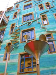 Musical building. As the rain water falls through the funnels they play a tune.