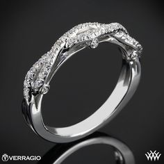 This Diamond Wedding Ring is from the Verragio Insignia Collection. It features 0.25ctw of Round Brilliant Diamond Melee (F/G VS) and will be a terrific addition to your Engagement Ring of choice. The width tapers from 3.7mm at the top down to 2.3mm at the bottom. Please allow 4 weeks for completion. Platinum rings carry a 5 week turnaround time. If you have any questions regarding this item then please contact one of our friendly diamond and jewelry consultants at 1-877-612-6770. This ring…