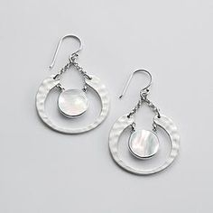 """Silver Crescent & Pearl earrings ~ """"Suggesting a new moon and its embracing gesture, the shape of these artisan-inspired earrings provides both nurturing comfort and style. Each silver crescent drops from a simple hook and surrounds an iridescent mother-of-pearl disc."""