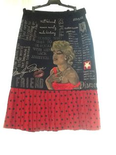 Marilyn Monroe Skirt.  I combined several pieces from Goodwill to make this cool skirt to wear in France (really, where else could I wear it?).  Hand painted (her hand is a bit wonkey, but very unforgiving technique on black skirt).  Jewelry attached with snaps for washing.