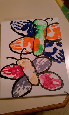 Butterflies made with Kids hand prints and foot prints.