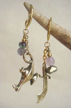 Asymmetrical Aladdin charm earrings, with pink and green stones. The Genie lamp and Arabian scimitar charms are re-cast in quality brass from antique charms. by lux  and love