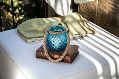 Handmade glass lanterns by Mdina Glass... with rope or leather handles in a range of shapes, sizes and colours.