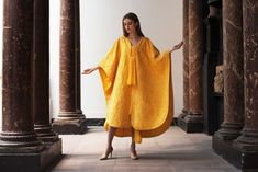 Bianca Gavrilas models a hand-embroidered cape made from the naturally golden silk of the Orb spider during a photocall at The Victoria & Albert Museum in London on January Spider Silk, Spider Art, Silk Gown, Gold Silk, Victoria And Albert Museum, Alternative Fashion, Cape, Spiders, Gowns