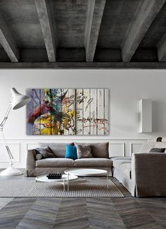 "This would be a great gallery space: Pinner says, ""Herringbone timber floors, concrete ceiling, linen sofas, white walls and colorful artwork!"""
