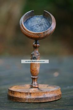 19th C.  Carved Walnut Pocket Watch Holder On A Circular Wooden Stand.
