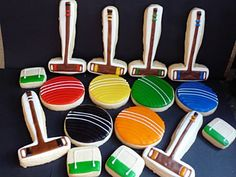 Croquet set of cookies, could use CopperGifts.com gavel cookie cutter for the mallet.