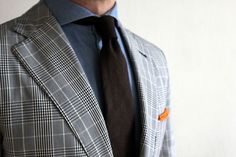 Blue spread collar shirt, black tie, glen plaid blazer, orange pocket square