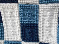 This crocheted blanket is an original design that is easy to complete. The entire blanket requires only three crochet stitches - chain stitch, single crochet and the popcorn stitch. This is a PATTERN ONLY and is not the finished product. The pattern includes the written