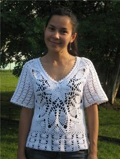 Lovely crochet top pattern with fans, pineapples and floral motifs. More Patterns Like This!