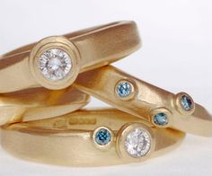 Rings in 18ct gold set with white and blue diamonds - Jennie Gill