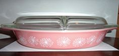 Vintage 1950 Pyrex divided casserole with lid Pattern: is pink daisy  1 1/2 Qt size where you can cook two different items. Great pink color with white flowers  The lid is divided down the middle also . It has a rough spot on the inside as shown in last picture  Marked Pyrex on the bottom  No chips other than the lid  Thanks for looking  Will ship in Large USPS priority box